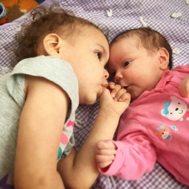 Sisters sharing a moment of bonding.